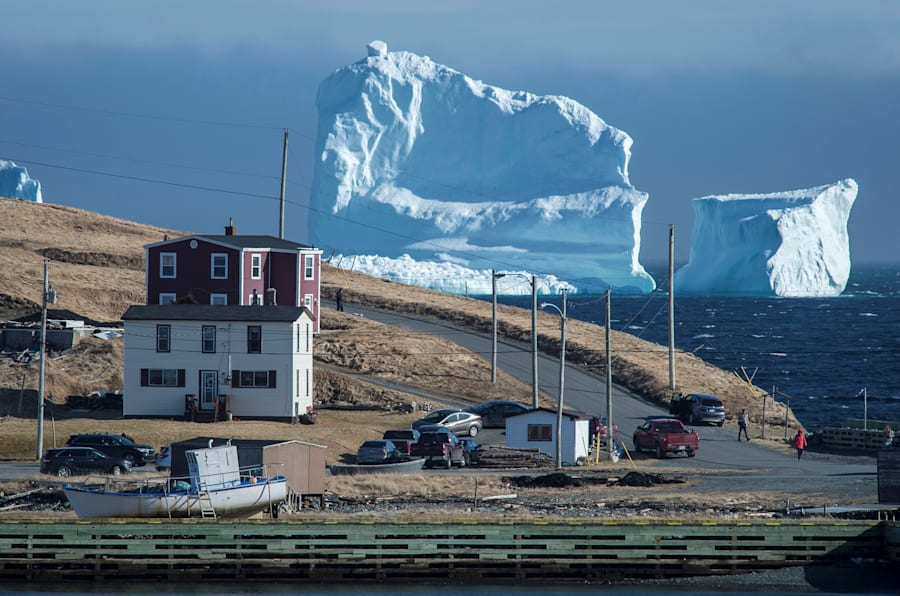 "Residents view the first iceberg of the season as it passes the South Shore, also known as ""Iceberg Alley"", near Ferryland Newfoundland, Canada April 16, 2017. Picture taken April 16, 2017. REUTERS/Greg Locke  TPX IMAGES OF THE DAY"