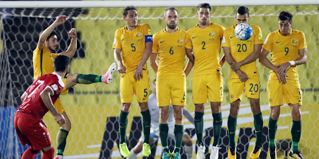 Omar Khrbin of Syria takes a free kick during the 2018 FIFA World Cup Asian Playoff match between Syria and the Socceroos.