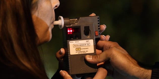 An RCMP officer performs a breathalyzer test on a driver during a roadside check in Surrey, B.C., on Sept. 24, 2010.