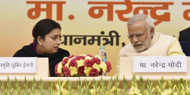 File photo of Prime Minister Narendra Modi talking to I&B Minister Smriti Irani.