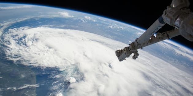 In this handout provided by NASA from the the Earth-orbiting International Space Station, weather system Arthur travels up the east coast of the United States in the Atlantic Ocean near Florida on July 2, 2014 in space. The robotic arm of the Space Station Remote Manipulator System or Canadarm2 is seen at upper right.