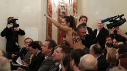 Une Femen seins nus évacuée sans ménagement d'une conférence de Marine Le