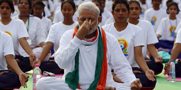 India's Prime Minister Narendra Modi performs yoga with others to mark the International Day of Yoga, in New Delhi, India, June 21, 2015. REUTERS/Adnan Abidi