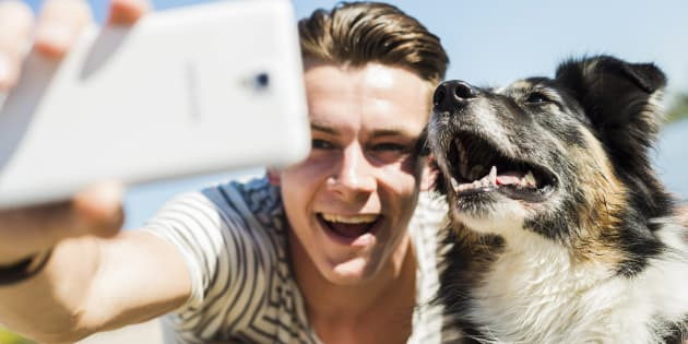 We love our pets so much we even include them in our selfies.