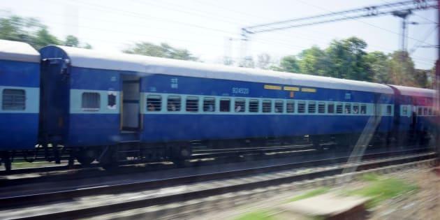Indian Passenger Train moving alongside,  Delhi, India