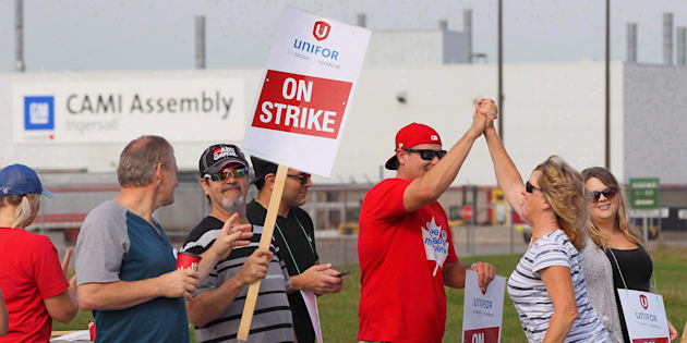 Employees of the GM CAMI assembly factory stand on the picket line in Ingersoll, Ont., on Sept. 18, 2017.