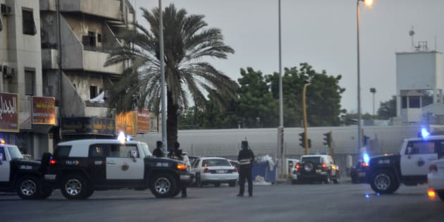 Saudi policemen stand guard at the site where a suicide bomber blew himself up in the near the American consulate in Jeddah.