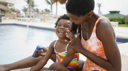 Kids Who Use Sunscreen Drastically Cut Risk Of Cancer As