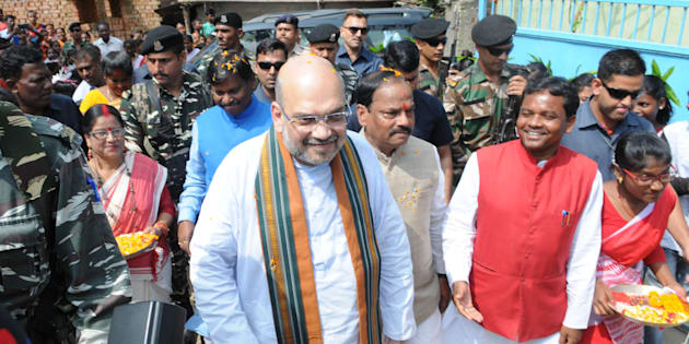 BJP President Amit Shah, along with Chief Minister Raghubar Das and former Chief Minister Arjun Munda, visits the residence of tribal Anil Oraon at Harmu locality.
