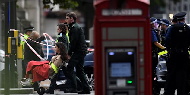 Emergency first responders wheel a woman in a wheelchair to an ambulance near the Natural History Museum, after a car mounted the pavement, in London on Saturday.