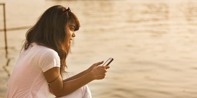 Young woman calling and texting on a mobile telephone