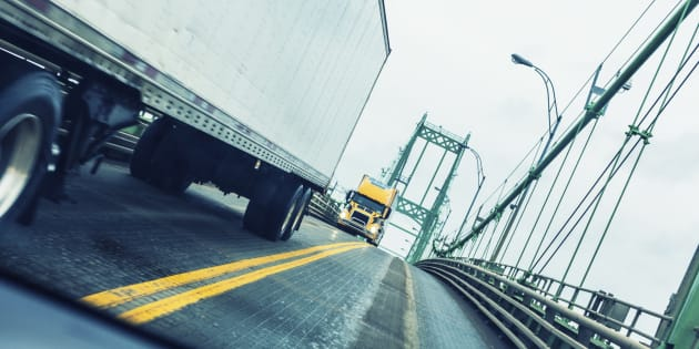 Trucks crossing the Canada-U.S. border at the Thousand Islands Bridge between Ontario and New York State. The federal government is taking steps to crack down on companies that try to ship cheap foreign steel and aluminum through the Canadian market.