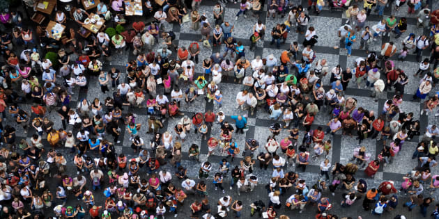 Aerial photograph of people visiting the Old Town Square in Prague