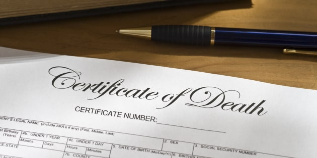 Blank Death Certificate on a desktop.