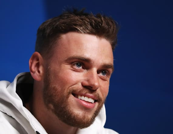 Gus Kenworthy shares kiss with boyfriend on live TV