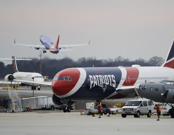 Patriots' plane brings a million masks to U.S.