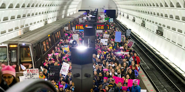 WASHINGTON, DC - JANUARY 21: Protesters arrive on the platform at the Capital South Metro station for the Women's March on Washington on January 21, 2017 in Washington, DC. Following the inauguration of Donald Trump as the 45th president of the United States, the Womens March has spread to be a global march calling on all concerned citizens to stand up for equality, diversity and inclusion and for womens rights to be recognised around the world as human rights.  (Photo by Jessica Kourkounis/Getty Images)
