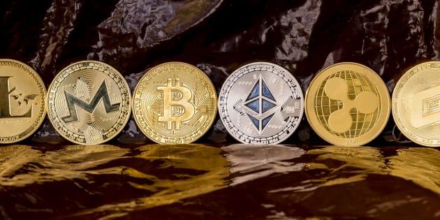 Quelques représentations de cryptomonnaies: Litecoin (LTC), Monero (XMR), Bitcoin (BTC), Ethereum (ETH), Ripple (XRP) et Dash.