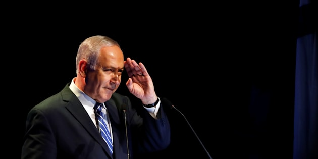 Israeli Prime Minister Benjamin Netanyahu gestures during a speech at a regional development conference in Dimona, southern Israel March 20, 2018. REUTERS/Ronen Zvulun