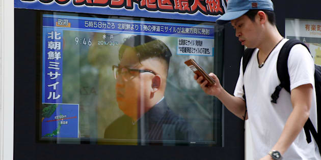 A man walks past a TV set showing North Korea's leader Kim Jong-Un in a news report about North Korea's missile launch in Tokyo, Japan, August 29, 2017.   REUTERS/Kim Kyung-Hoon     TPX IMAGES OF THE DAY