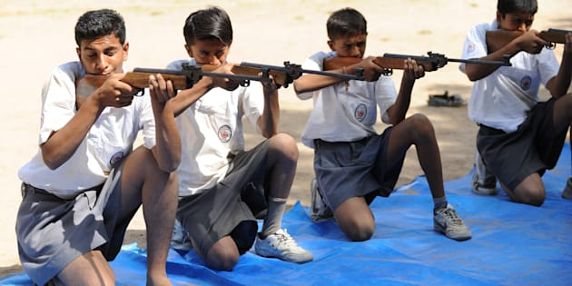 Volunteers of Bajrang Dal participate in the air rifle training session at a youth camp on the outskirts of Ahmedabad in the early morning of May 17, 2012.