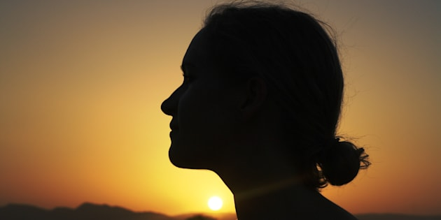 Silhouette of a young woman at sunset. Image used for representational purposes only.