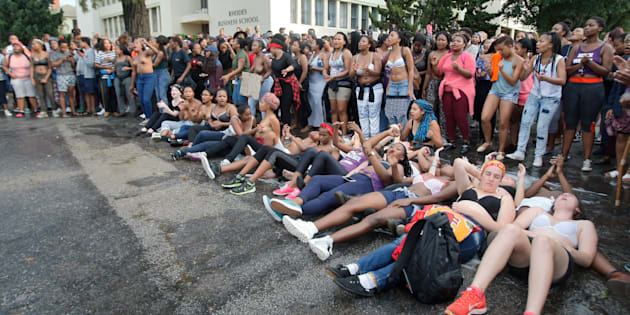 Rhodes University students lay on their backs during protests against sexual violence in the institution on April 19, 2016 in Grahamstown, South Africa. This comes after the names of 11 students accused of rape were posted on social media.