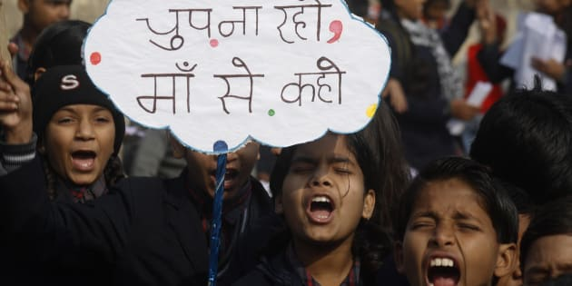 Indian children shouting slogans to create awareness about child sexual abuse in a rally.