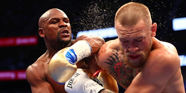 Aug 26, 2017; Las Vegas, NV, USA; Floyd Mayweather Jr. lands a hit against Conor McGregor during their boxing match at the at T-Mobile Arena