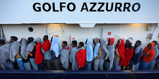 Migrants line up as they wait to be processed by Italian authorities aboard the former fishing trawler Golfo Azzurro moored in the port of Augusta following their rescue by Spanish NGO Proactiva Open Arms from their drifting dinghies off the Libyan coast in central Mediterranean Sea April 2, 2017. REUTERS/Yannis Behrakis