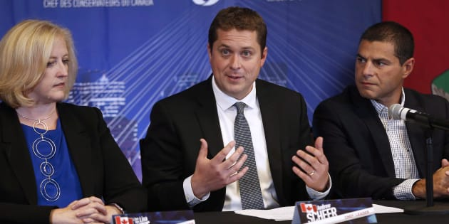 Conservative Leader Andrew Scheer speaks, as Lisa Raitt and Alain Rayes listen in at his shadow cabinet meeting in Winnipeg on Sept. 6, 2017.