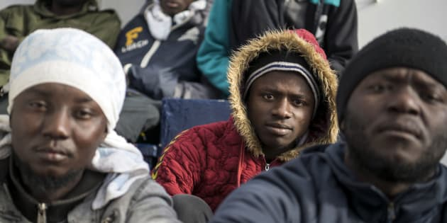 Migrants aboard the Sea-Eye rescue ship, in the Mediterranean Sea, Tuesday, Jan. 8, 2018. Two German nonprofit groups are appealing to European Union countries to take in 49 migrants whose health is deteriorating while they are stuck on rescue ships in the Mediterranean Sea. Sea-Watch and Sea-Eye representatives told reporters in Berlin on Tuesday that drinking water was being rationed on their ships and some migrants had trouble eating due to illness.  (AP Photo/Rene Rossignaud)