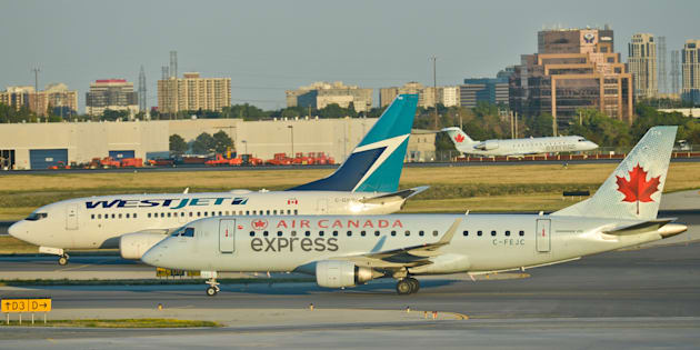 "Air Canada and WestJet planes at Toronto's Pearson International Airport. Wed. July 20, 2016. Airfare prediction app Hopper says Canada's two largest airlines are partnering with it to unload some of their seats via ""secret fares"" starting today at up to a 35 per cent discount."
