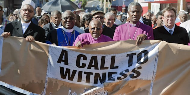 Desmond Tutu (C), Anglican archbishop emeritus, and Nobel Peace Laureate joins other religious leaders, and a wide range of people from civil society on a march called ' Procession of Witness'. On Tutu's left is current Anglican Archbishop, Thabo Makgoba.