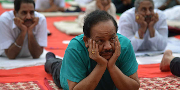 Harsh Vardhan, Indian Union Minister for Environment, Science and Technology, takes part in a yoga session on International Yoga Day in  Amritsar.