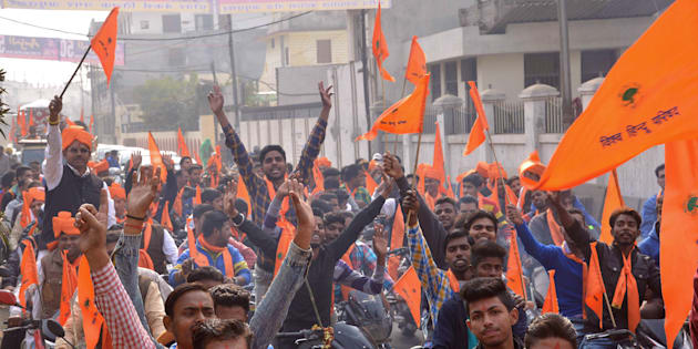 Indian activists of Hindu Bajrang Dal, along with Vishva Hindu Parishad (VHP) organizations, raise religious slogans during a procession marking the 23rd anniversary of the demolition of the Babri Masjid Mosque in Ayodhya.