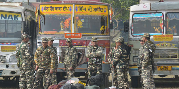 Indian paramilitary soldiers standing guard as they wait to be deployed to provide security during the forthcoming Punjab election at distribution centre in Amritsar on February 3, 2017.