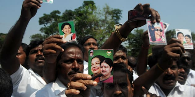 Members of the All India Anna Dravida Munnetra Kazhagam (AIADMK) party display portraits of VK Sasikala and former Tamil Nadu Chief Minister Jayalalithaa Jayaram, as they celebrate in front of the governors residence after AIADMK leader Edapadi Palanisamy was called to be sworn in as Chief minister of Tamil Nadu in Chennai on February 16, 2017. / AFP / ARUN SANKAR        (Photo credit should read ARUN SANKAR/AFP/Getty Images)