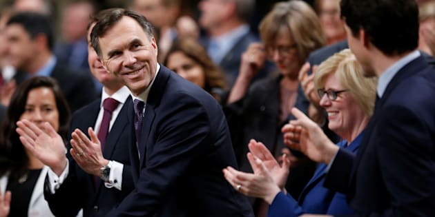 Finance Minister Bill Morneau receives a standing ovation as he arrives to deliver the budget in the House of Commons on Feb. 27, 2018.