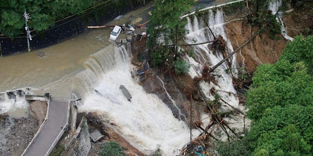 A collapsed road is seen following torrential rain caused by typhoon Lan in Kishiwada, Japan in this photo taken by Kyodo on October 23, 2017.