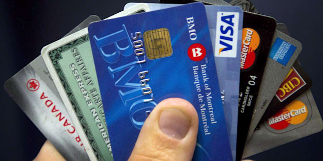 Fewer Canadians are paying off their credit cards in full, a sign that debt delinquencies could soon be on the rise, credit rating agency Equifax says.