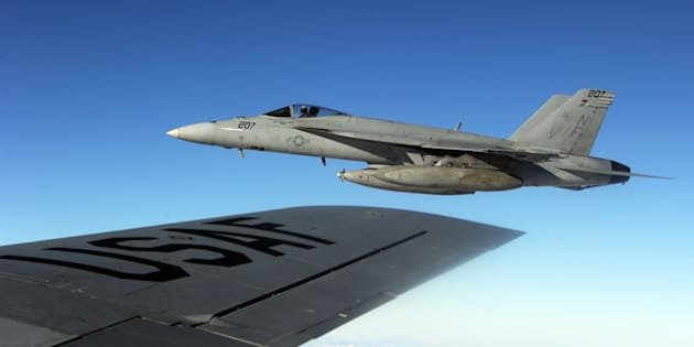 A US Navy FA-18 Super Hornet is seen from a KC-135 air refuelling tanker during 'Keen Sword', US-Japan military exercise above the South China sea on December 9, 2010. Around 10,500 US service members and their Japanese Self Defence Forces counterparts participated in the eight-day-long exercise which started on Decomber 3.    AFP PHOTO / TOSHIFUMI KITAMURA (Photo credit should read TOSHIFUMI KITAMURA/AFP/Getty Images)