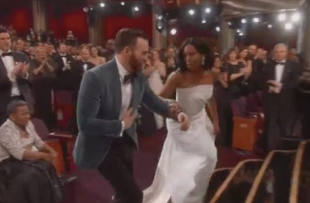 Chris Evans helps Regina King to the Oscars stage, proving ...