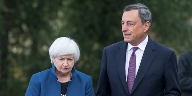Janet Yellen, chair of Board of Governors of the Federal Reserve System, left, and Mario Draghi, president of the European Central Bank, walk the grounds at the Jackson Hole economic symposium, sponsored by the Federal Reserve Bank of Kansas City, in Moran, Wyoming, U.S., on Friday, Aug. 25, 2017. Yellen issued her broadest defense so far of the government's response to the 2008 financial-market meltdown while outlining some areas that regulators could review to improve efficiency in the financial system. Photographer: David Paul Morris/Bloomberg via Getty Images