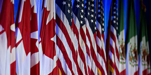 Canadian, American and Mexican flags stand on stage ahead of the first round of North American Free Trade Agreement (NAFTA) renegotiations in Washington, D.C. on Aug. 16, 2017. (Photo: Andrew Harrer/Bloomberg via Getty Images)