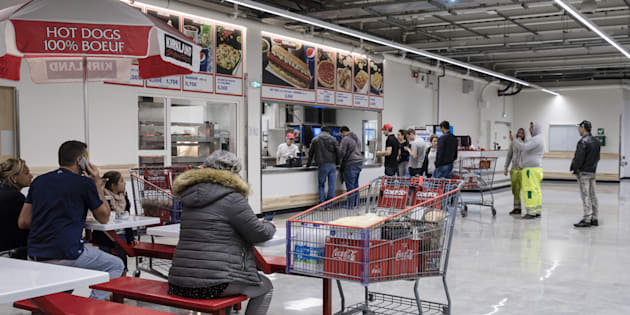 Customers line up for ready cooked food at the cafe inside a Costco Wholesale Corp. store in Villebon-sur-Yvette, France, on Friday, Nov. 3, 2017.