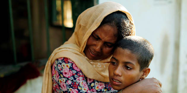 Rashida, 10, and her mother, who survived after a boat capsized, while five of their family members are among the many who died or have gone missing while fleeing Myanmar, react at a local madrasa in Teknaf, Bangladesh, Oct. 16, 2017.