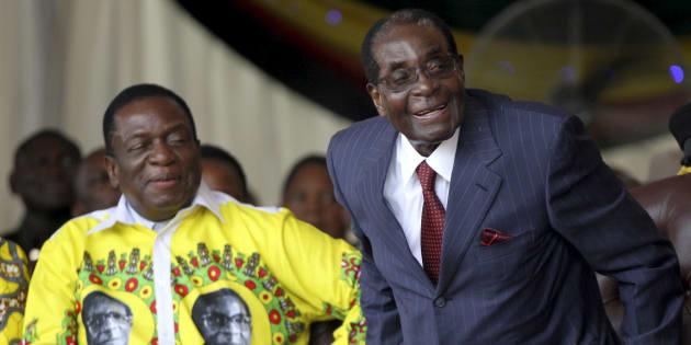 Robert Mugabe (R) shares a joke with President Emmerson Mnangagwa during Mugabe's birthday celebrations at Great Zimbabwe in Masvingo. February 27, 2016.