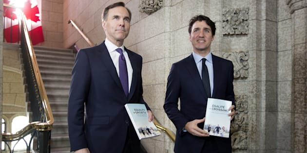 Prime Minister Justin Trudeau, right, and Finance Minister Bill Morneau arrive at the House of Commons before tabling the federal budget in Ottawa, Tues. Feb. 27. A new analysis says roughly 900 Canadian families earning less than $100,000 a year will have to pay more taxes because of federal changes to tighten income-sharing rules for owners of small businesses.