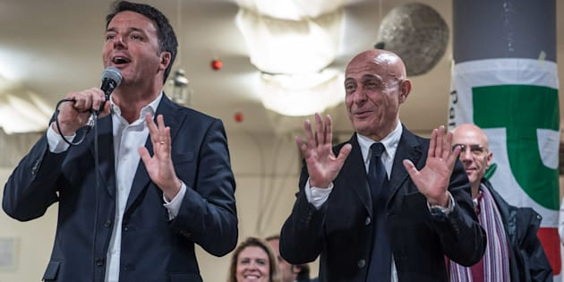 Matteo Renzi, leader of Italy's Democratic Party, left, and Marco Minniti, Italy's interior minister, speak at a general election campaign event in Florence, Italy, on Monday, Feb. 12, 2018.